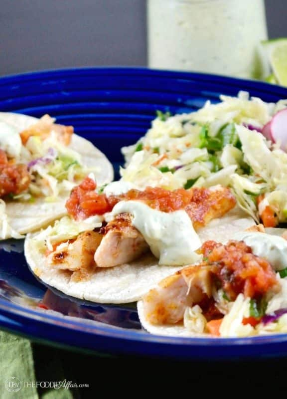 Healthy Fish Tacos recipe with fresh caught cod topped with salsa, avocado cream and slaw #fishtaco #healthy #Mexicandish | www.thefoodieaffair.com