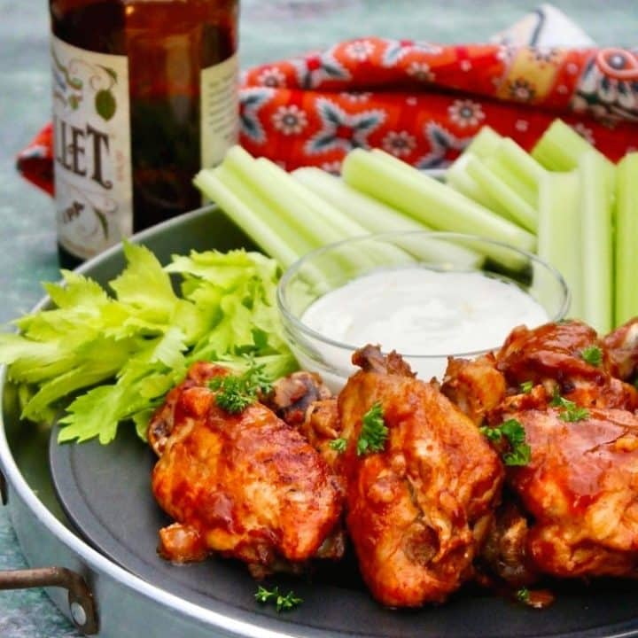 chicken wings on a tray with celery sticks