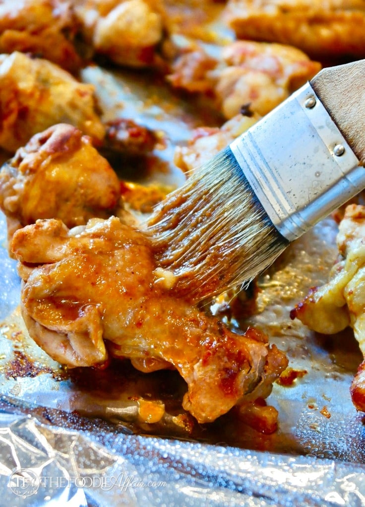 Chicken wings coated with a homemade BBQ sauce broiled after cooking in an Instant Pot #Instantpot #appetizer #recipe #chicken   www.thefoodieaffair.com