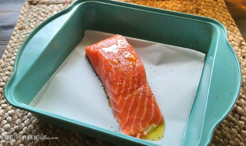 Fresh salmon on teal baking pan