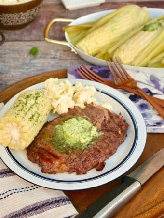 Grilled Rib Eye Steak with Corn on a white plate