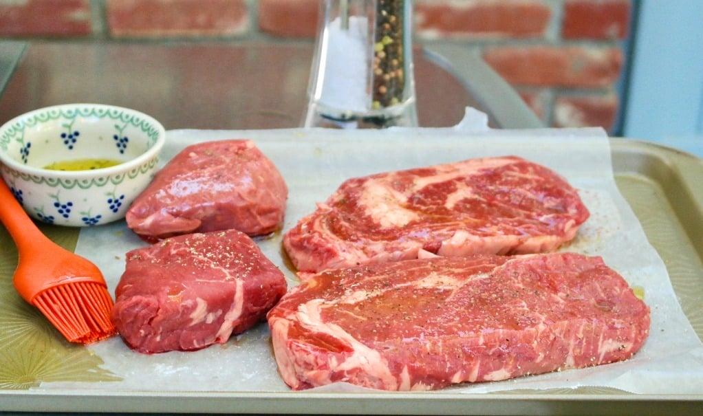 Grass fed rib eye steak on a baking sheed
