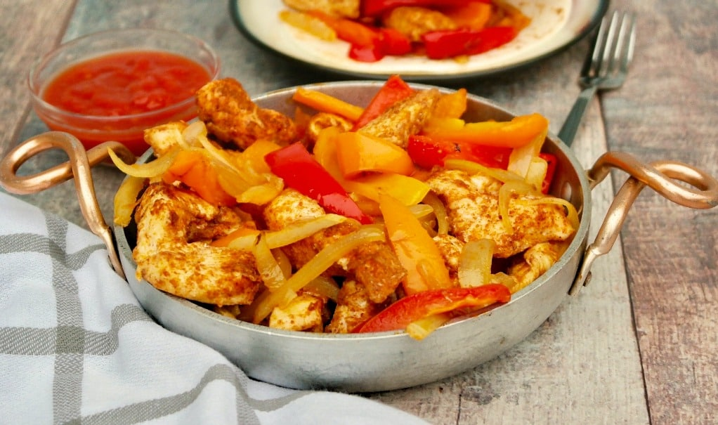 platter of baked chicken fajitas