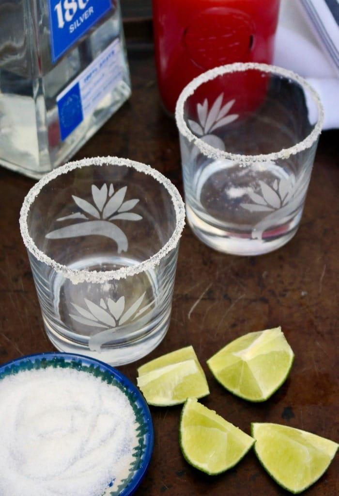 Preparing glasses for watermelon rita cocktail
