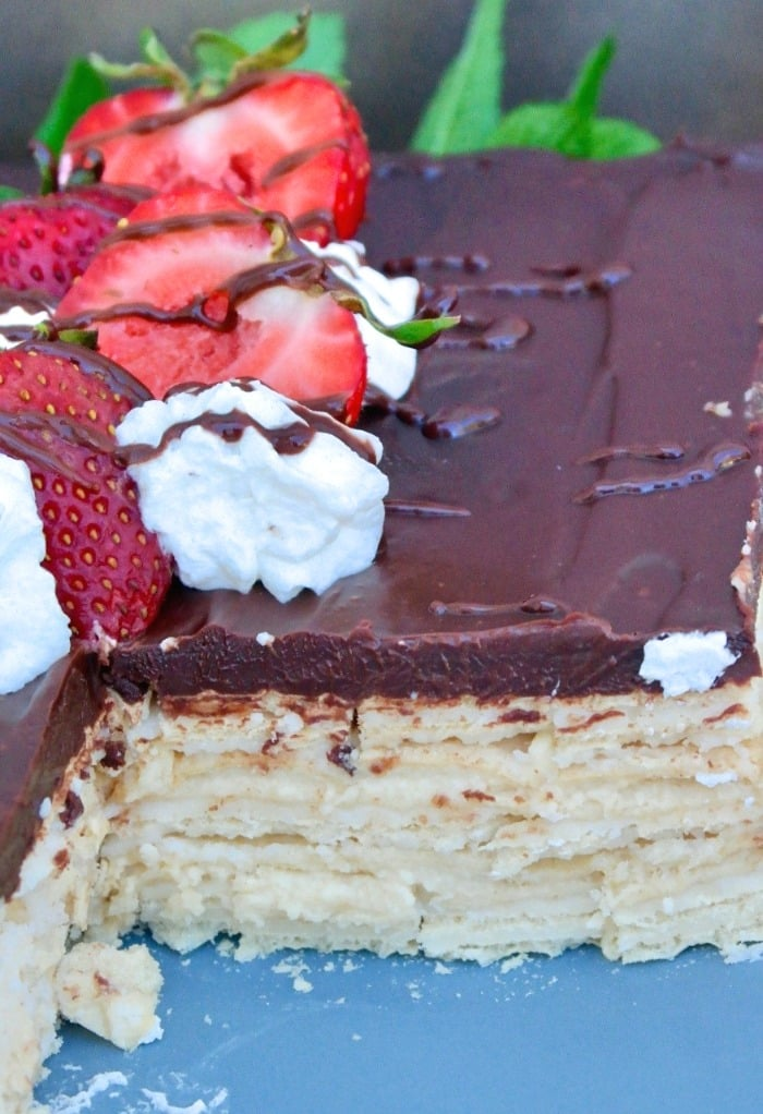 Eclair dessert sliced with strawberries