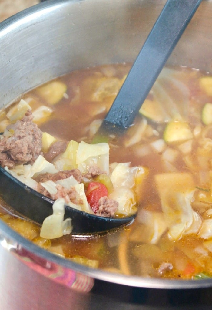 beef cabbage soup simmering in a silver pot