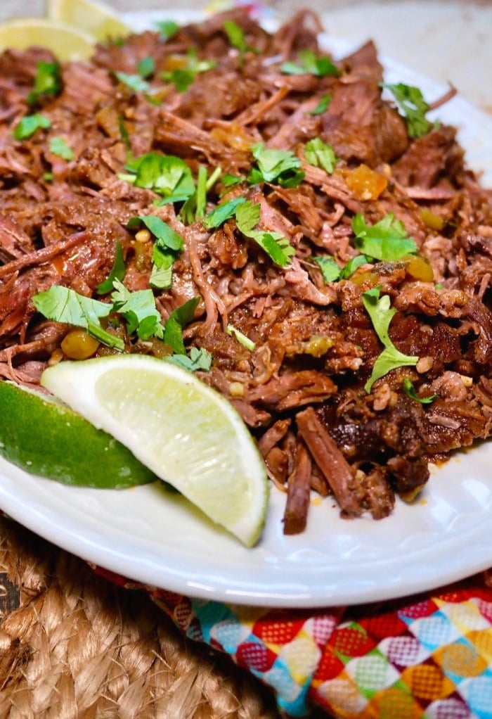 Mexican flavored beef on a white plate with cilantro