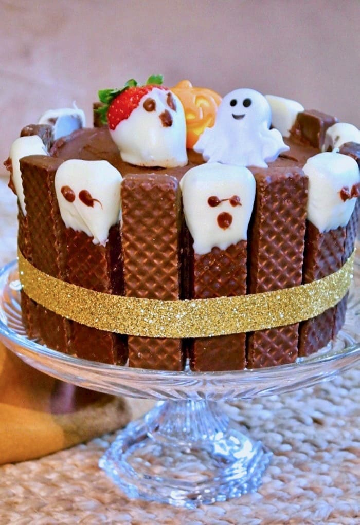 Ghost chocolate halloween cake on a crystal plate