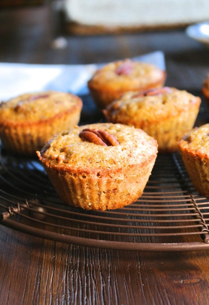 pecan muffins cooling on a baking rack