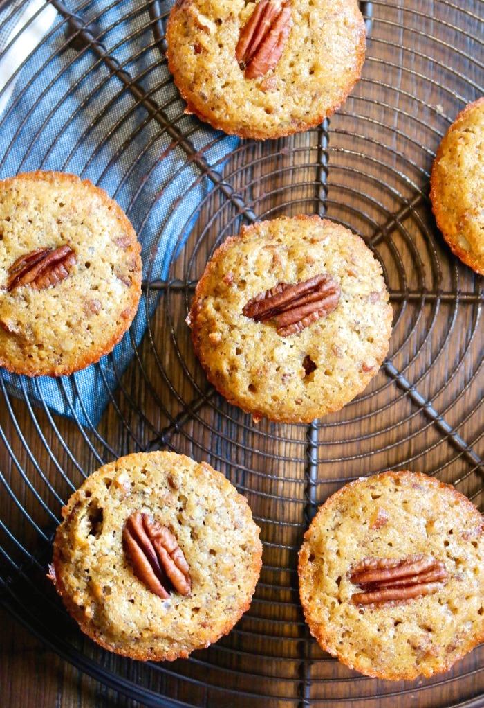 half dozen pecan muffins on a baking rack