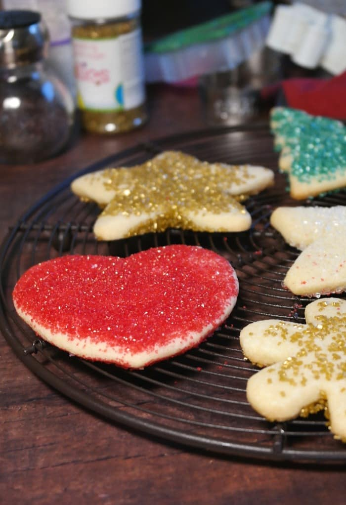 Heart and star cut out cookies cooling on a baking rack