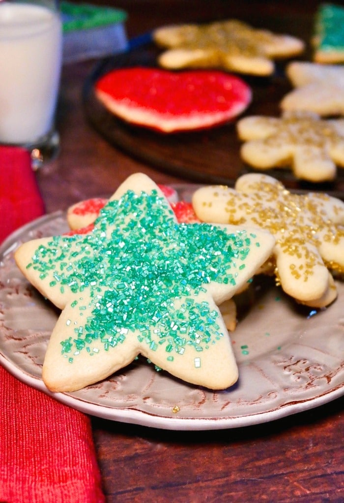Star and snowflake cut out cookies on a tan plate