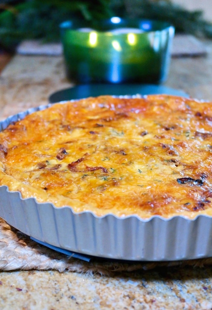 Baked cheese and onion quiche in a tin pan