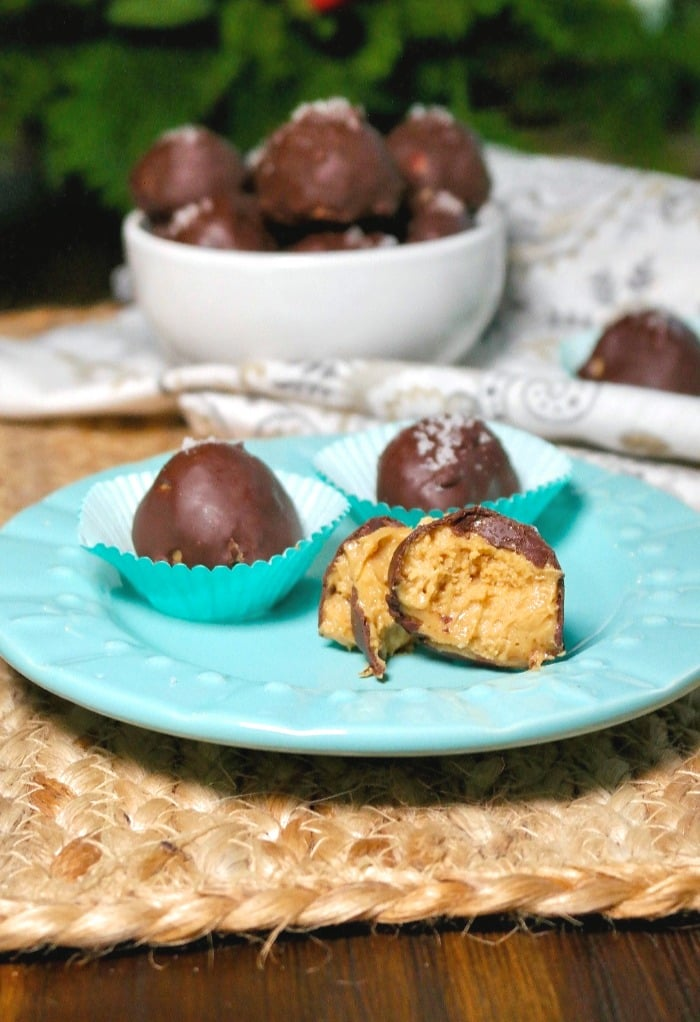 Chocolate peanut butter fat bombs on a teal plate