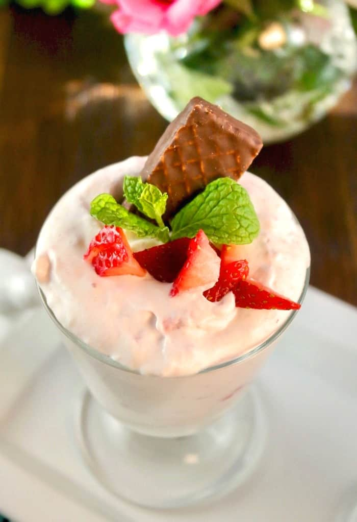 Strawberry mousse with chocolate wafer cookie and mint leaves