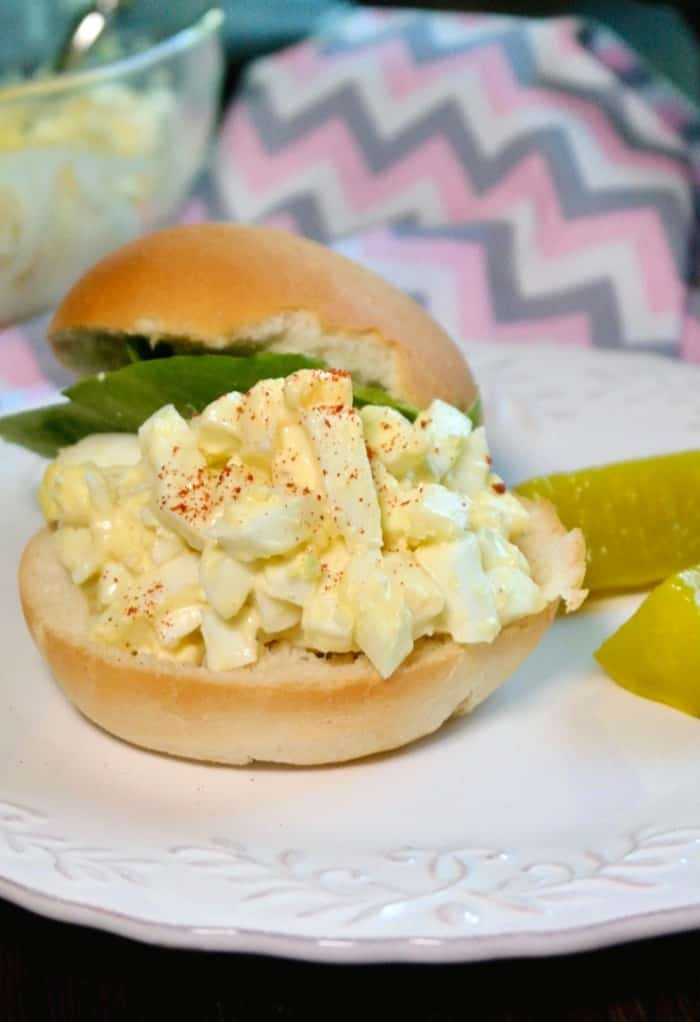 keto egg salad on half of a roll