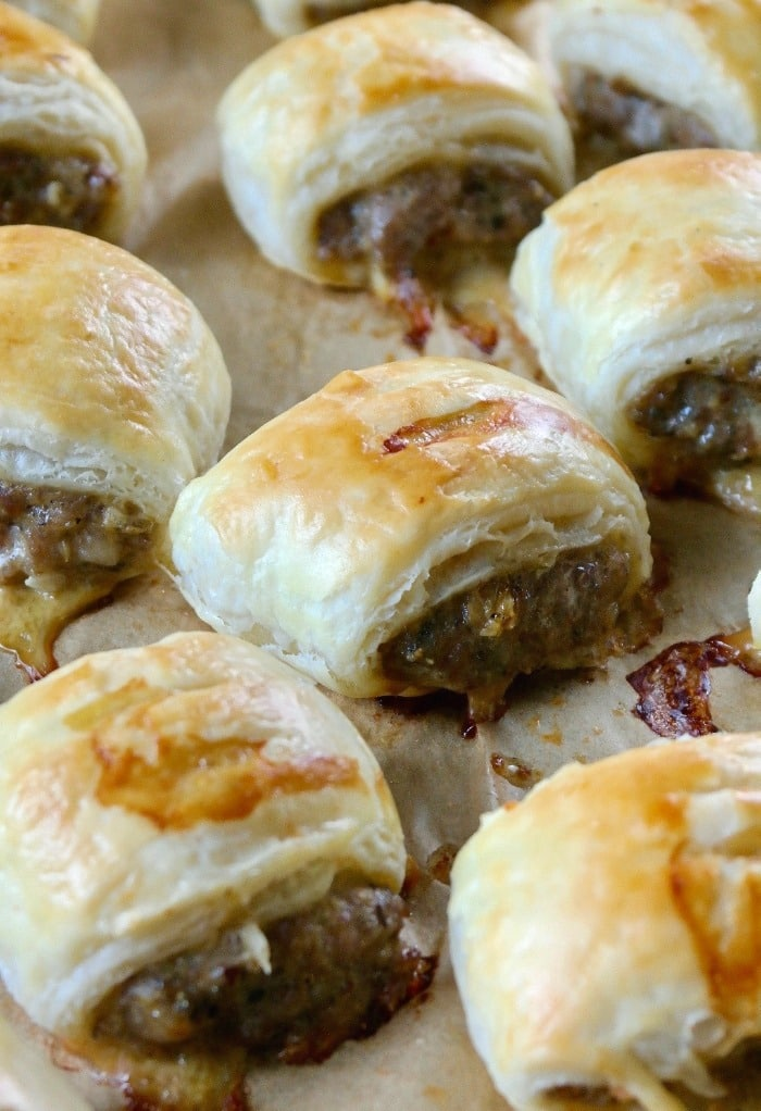 Sausage roll recipe on a baking sheet freshly cooked