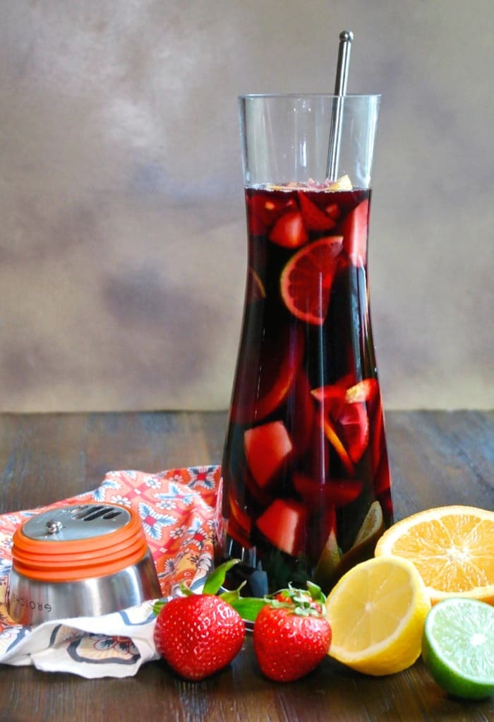 Red wine Spanish sangria in a glass decanter with fresh diced fruit
