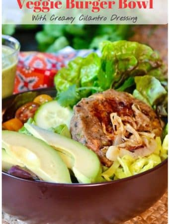 Easy flavorful veggie burger bowl loaded with lettuce, tomatoes, avocado slices, cucumbers and grilled onions topped with a creamy cilantro dressing. #ad #easyrecipe #vegetarian #meatless #latin #bubba #salad #thefoodieaffair