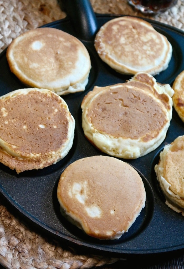 Silver dollar size pancakes on a skillet