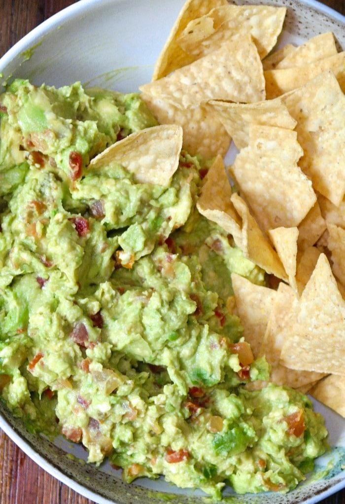 Easy guacamole recipe with prepared salsa in a white bowl