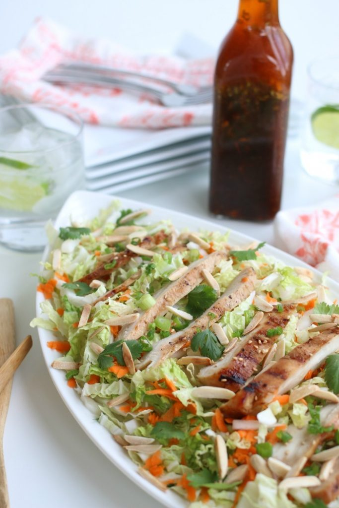 Delicious Asian inspired grilled chicken salad on a serving platter.