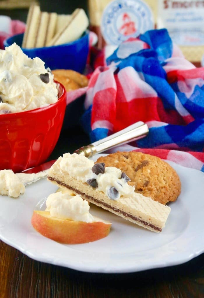 chocolate chip dip recipe with cookies and apple slice on a white plate