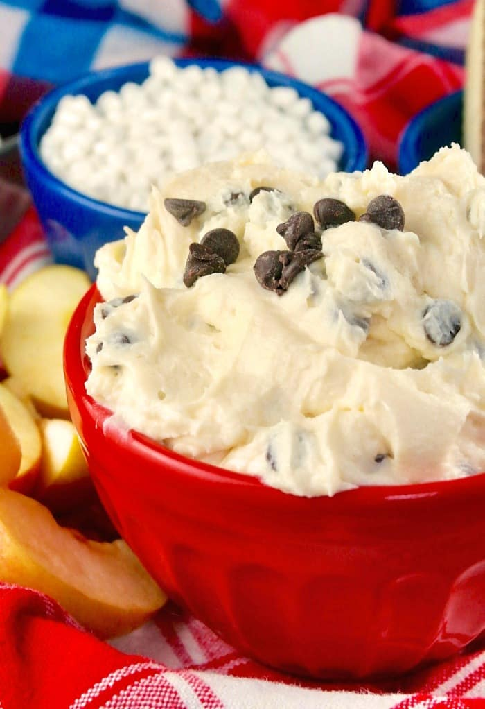 cream cheese dip with chocolate chips in a red serving bowl