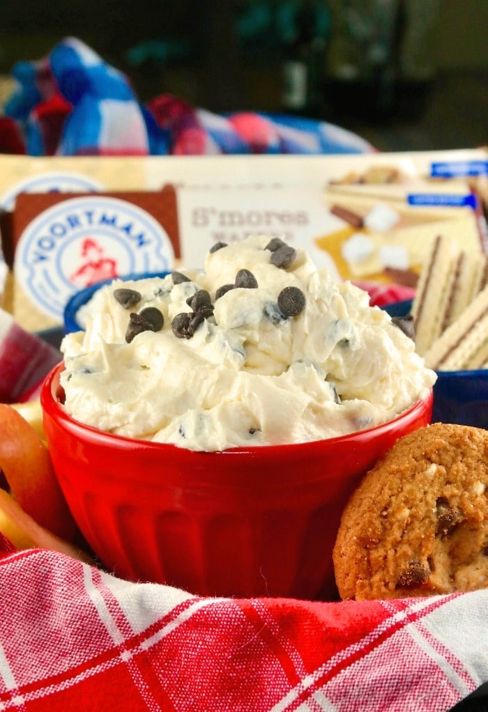 Red bowl with chocolate chip with cream cheese for dipping cookies