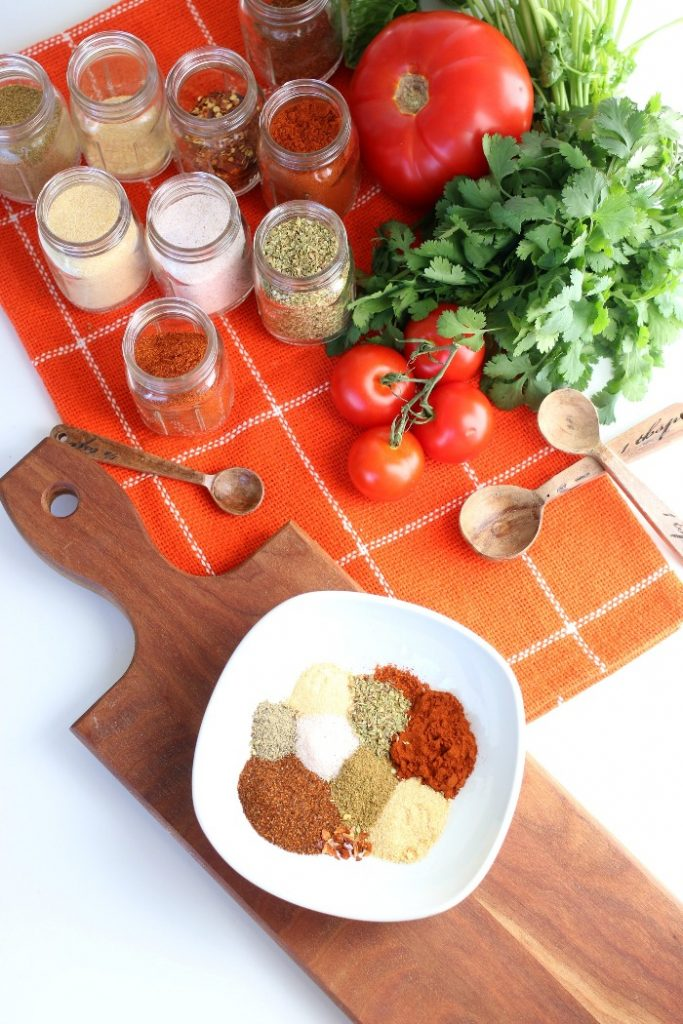 Overhead view of the ingredients for a diy taco seasoning recipe.