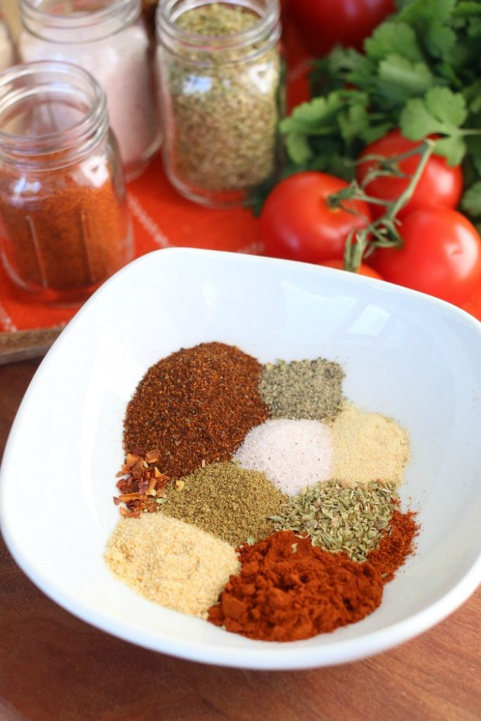 Individual spices in a bowl for taco seasoning recipe.