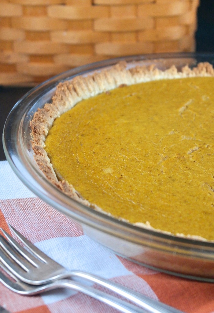 gluten free pumpkin pie in a clear pie dish
