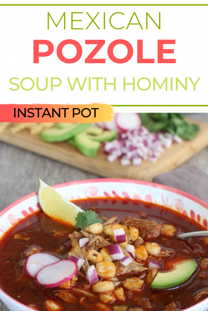 Pozole Mexican soup with hominy topped with radish and avocado.