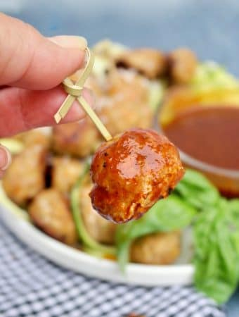 Turkey meatball dipped in sauce
