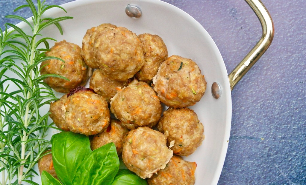 Healthy turkey meatballs on a white serving dish.