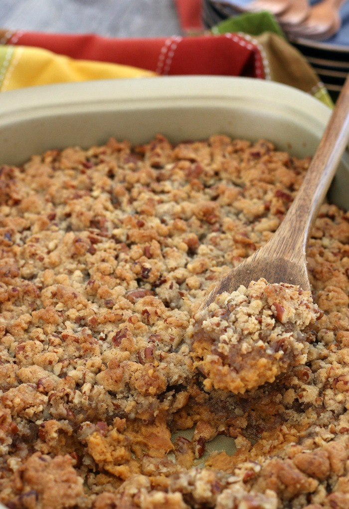 Finished sweet potato casserole easy version with a scoop out of it, ready to be served and enjoyed.