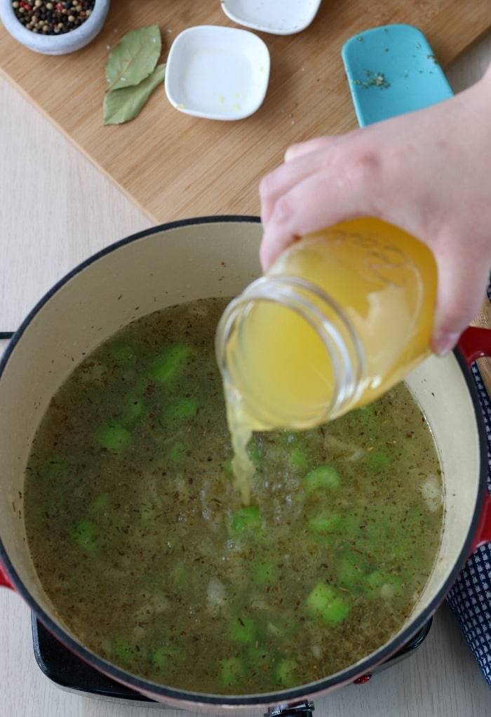Adding the stock is an important step for any good chicken soup recipe!