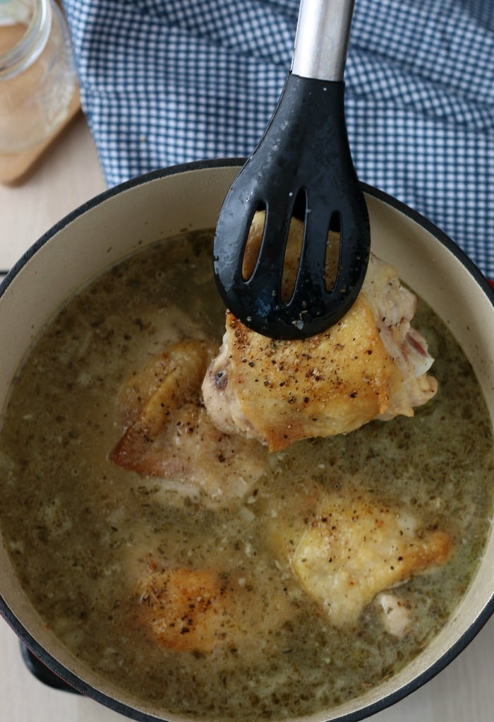 Now we see the chicken thighs being added back into the pot for low carb chicken soup.