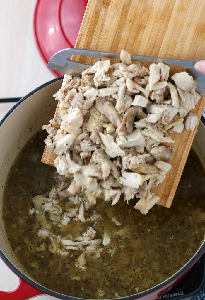 Chopped chicken is added back into the pot before we serve up this delicious chicken soup recipe.