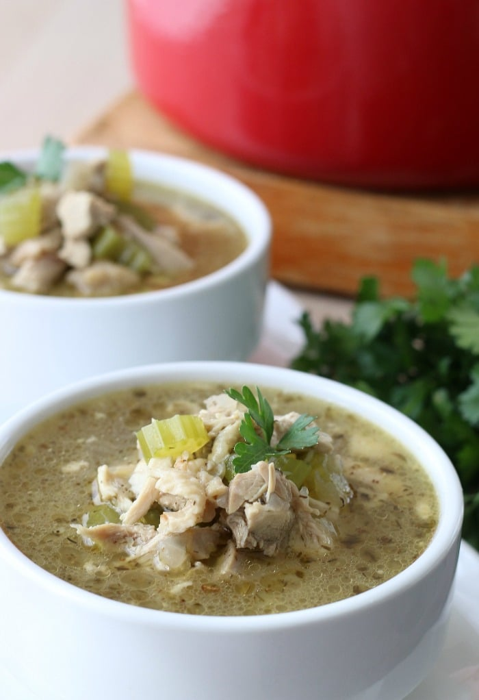 Close up shot of one of the bowls of finished ket chicken soup.