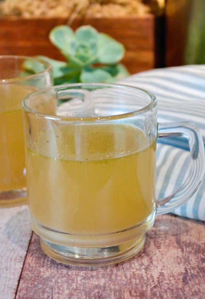 Clear cup of bone broth made in an Instant Pot