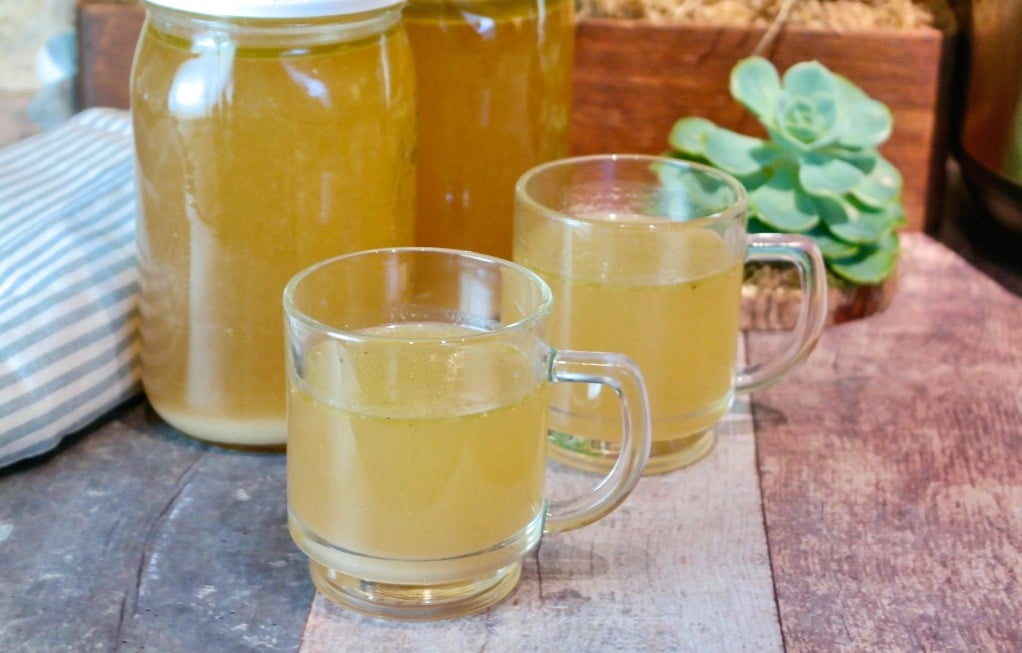 Two clear cups of turkey stock made in an Instant pot