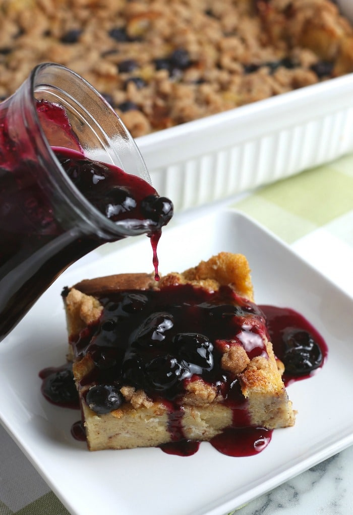 This image shows the blueberry topping being added to the french toast bake. The most delicious addition!