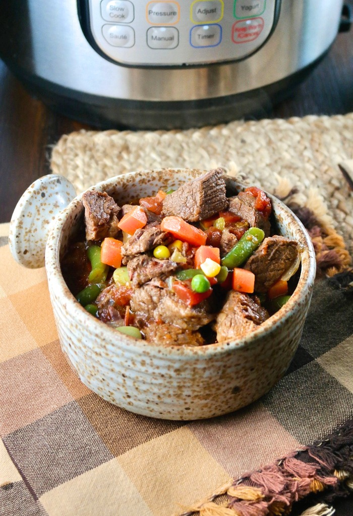 a bowl of beef vegetable stew cooked in an Instant Pot pressure cooker