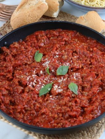 Homemade meat sauce in a skillet simmering