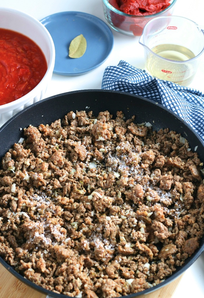 Seasoning the meat is essential for a flavorful meat with sauce recipe.