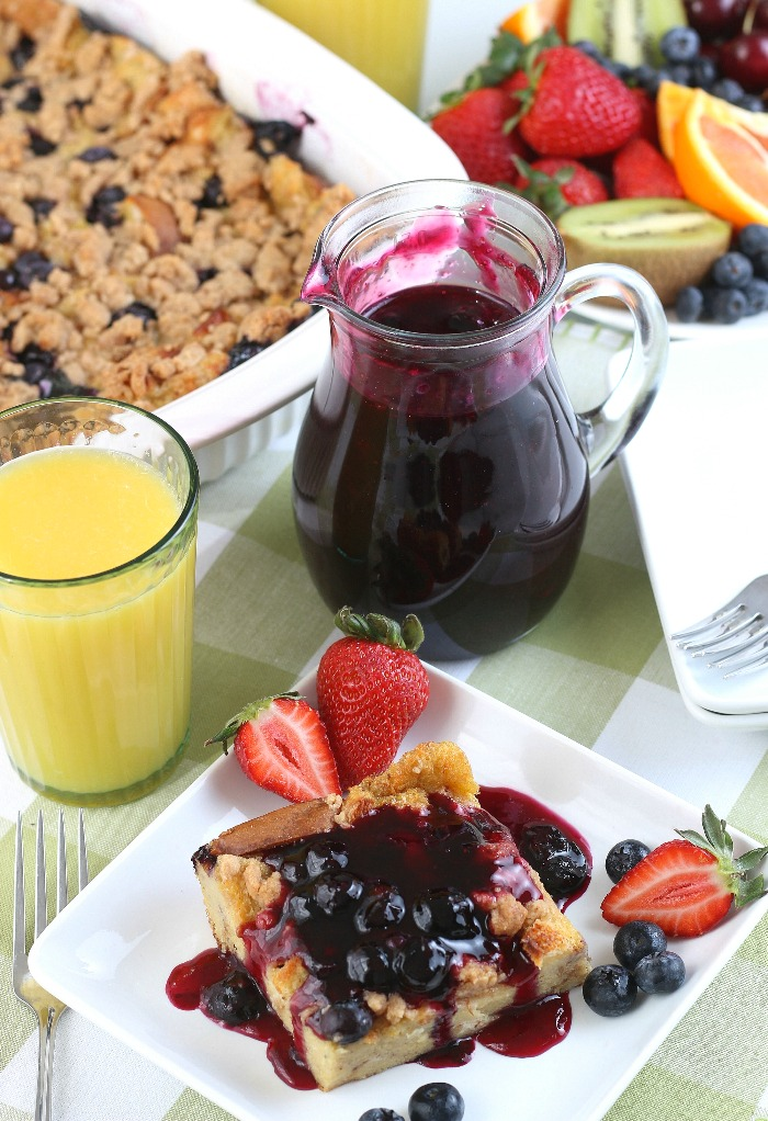 A complete French toast breakfast casserole with blueberry syrup