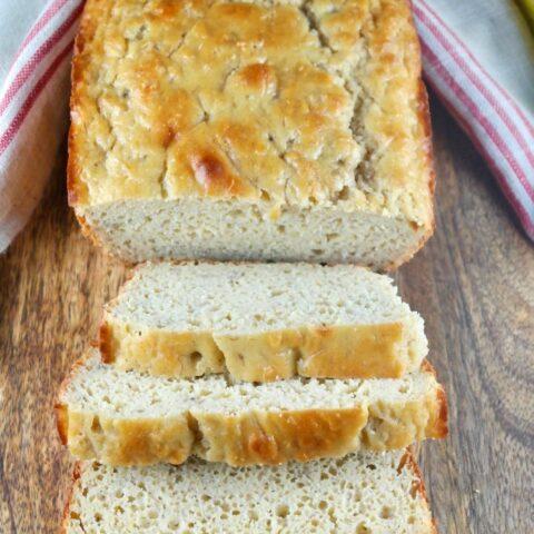Sliced loaf of healthy banana bread on a cutting board