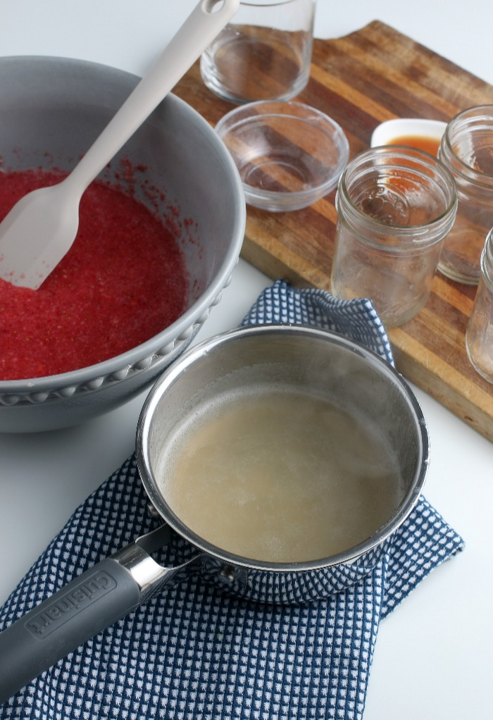 Now that the gelatin is mixed up we can add it to our berry mixture before the freezer jam goes into the glasses.