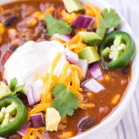 Close up shot of taco soup topped with sour cream